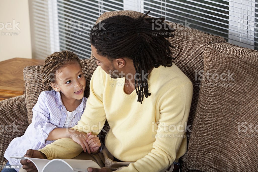 Little girl reading with father royalty-free stock photo