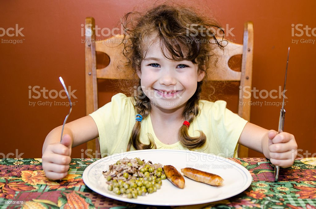 Little girl ready and happy to eat stock photo