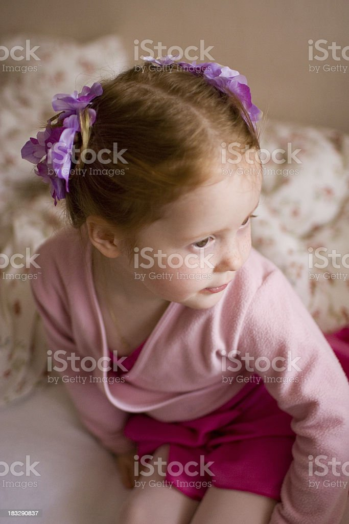 Little 3 year old girl in pink ballet clothes. From top. Shallow DOF...