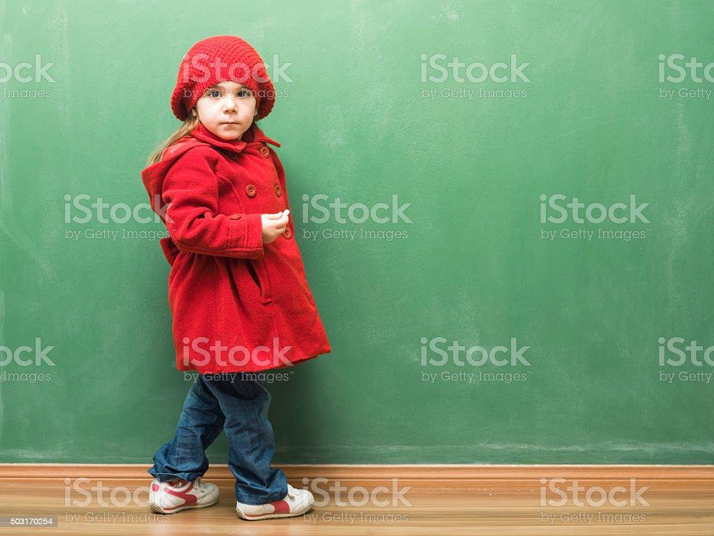 Little Girl Ready For Writing On Blank Blackboard stock photo