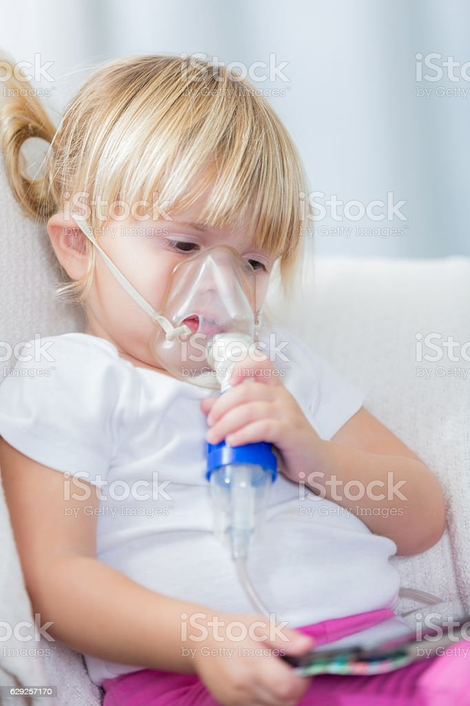 Little girl receives breathing treatment stock photo