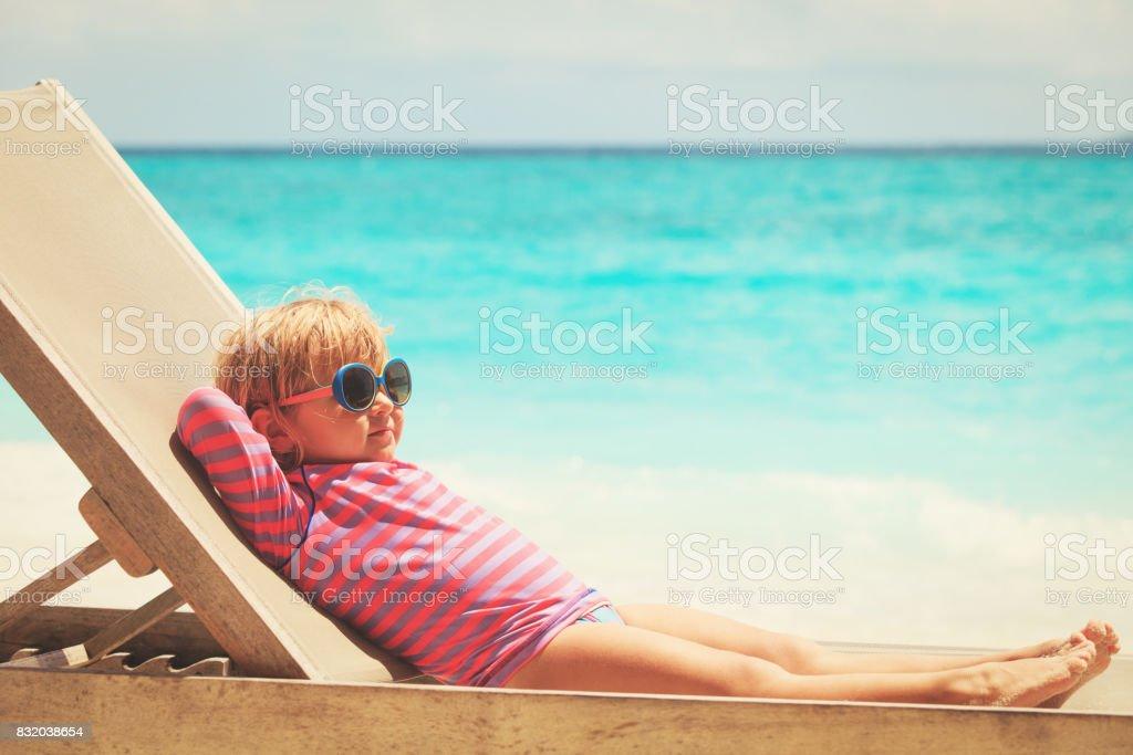 little girl relaxed on summer beach stock photo