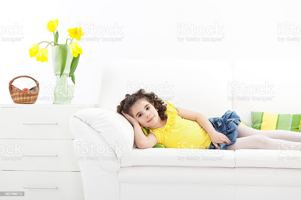 Little girl relaxing at sofa on Easter day royalty-free stock photo