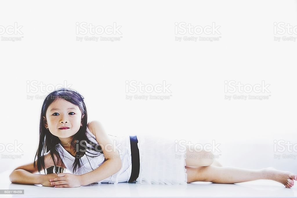 Little girl relaxing on floor. royalty-free stock photo