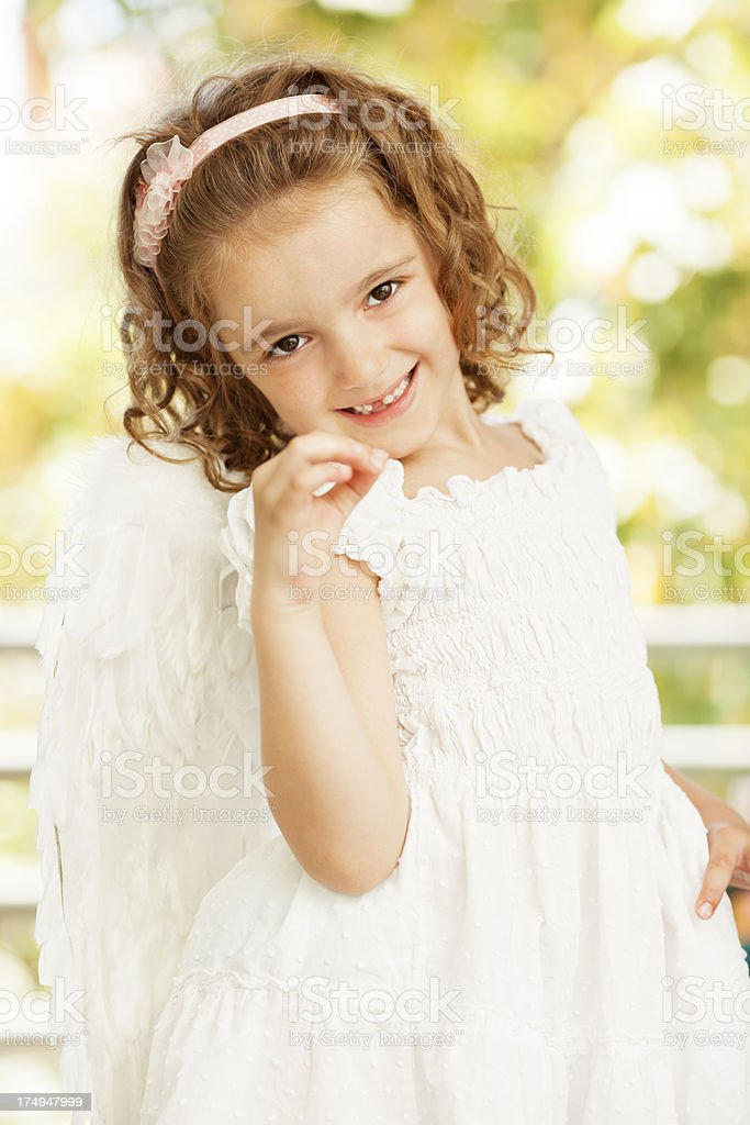Little Girl Removing Tooth royalty-free stock photo