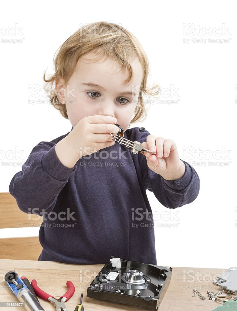 little girl repairing computer parts stock photo