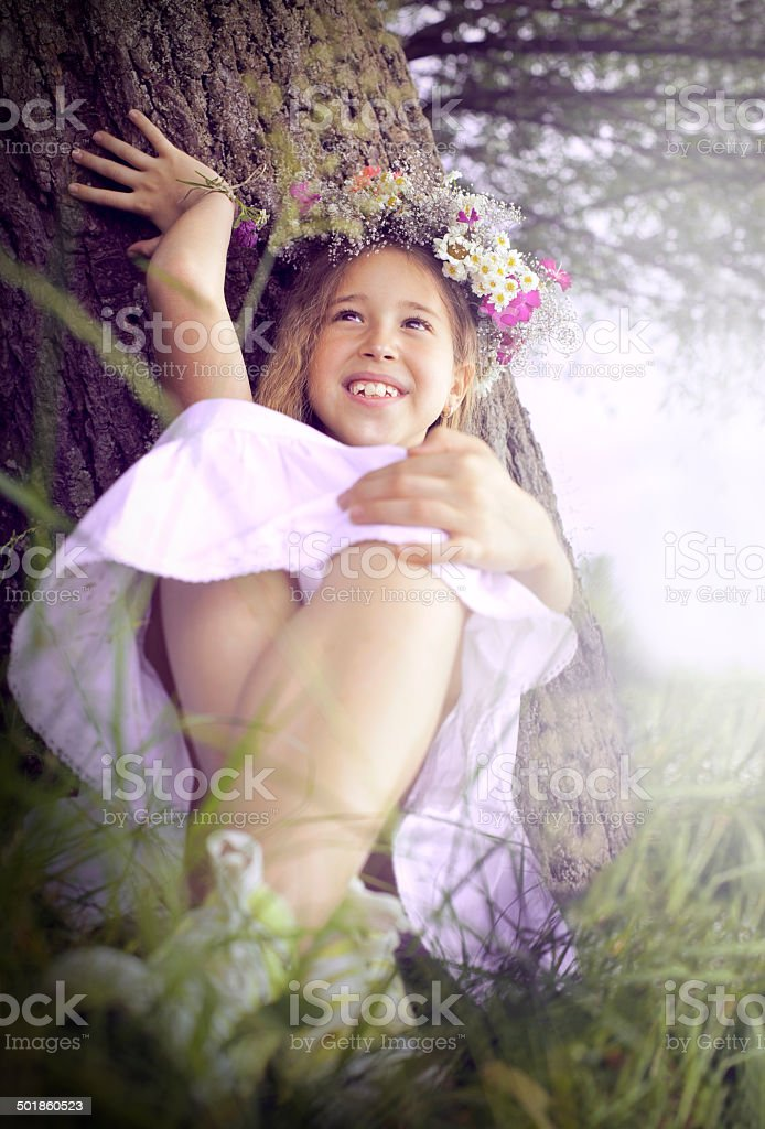 Little girl rest on a summer meadow royalty-free stock photo
