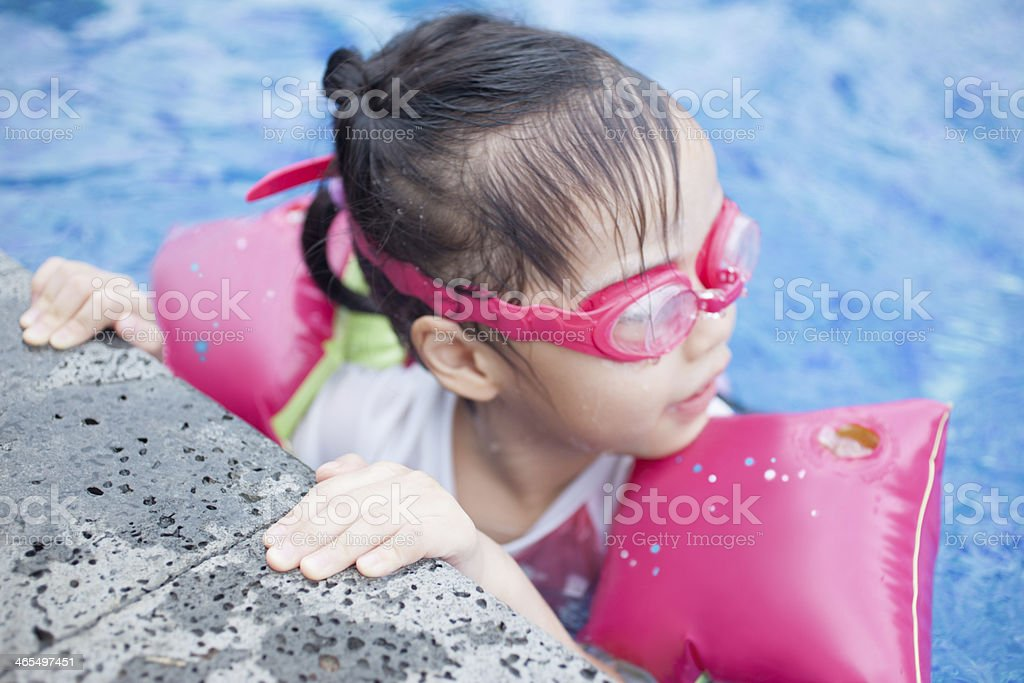 Little Girl Resting by the Swimming Pool royalty-free stock photo