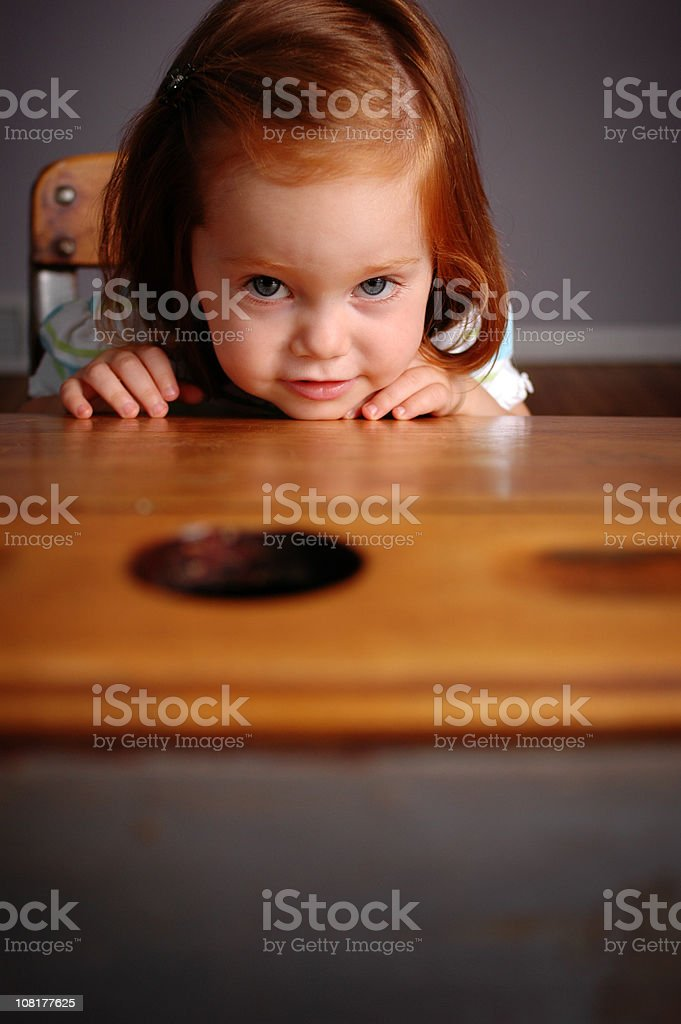 Little Girl Resting Chin on School Desk royalty-free stock photo