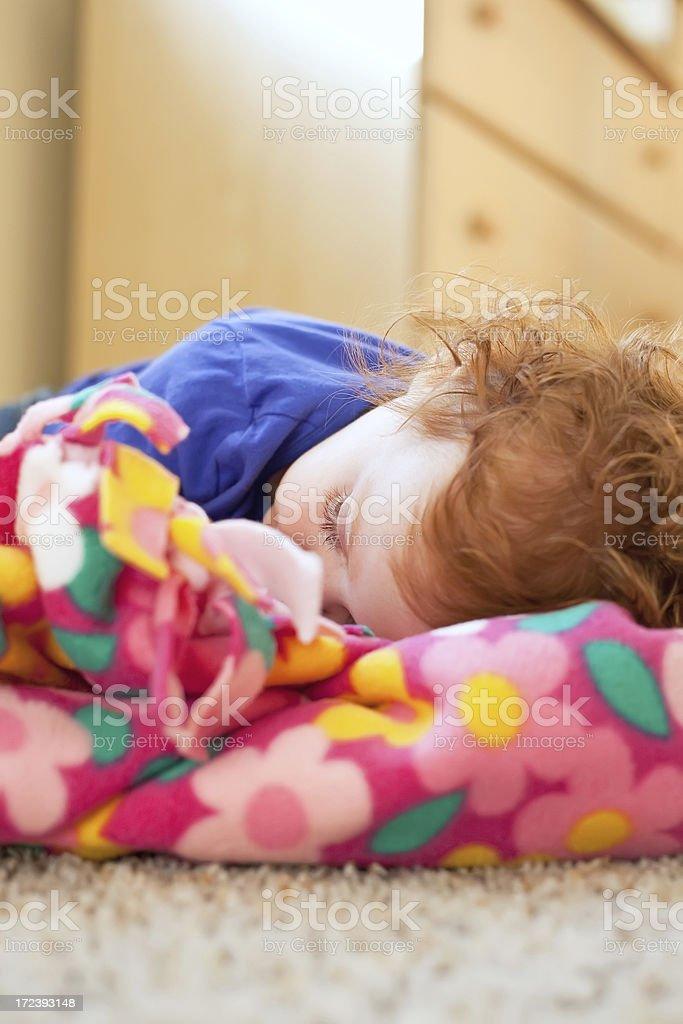 Little Girl Resting on Blanket royalty-free stock photo