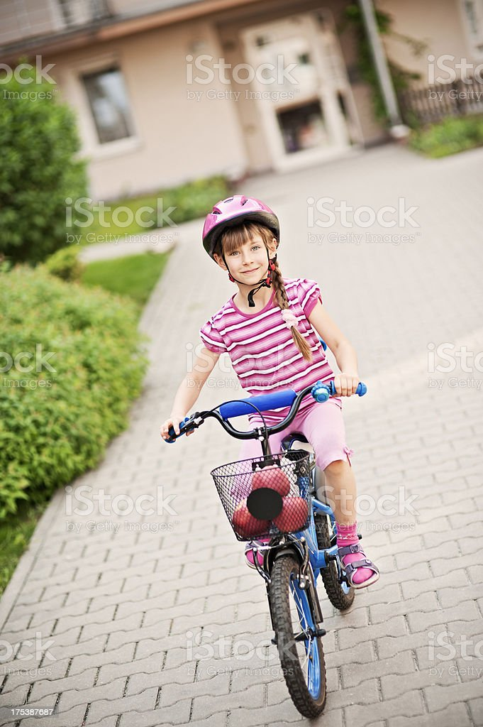 Little girl riding a bicycle royalty-free stock photo