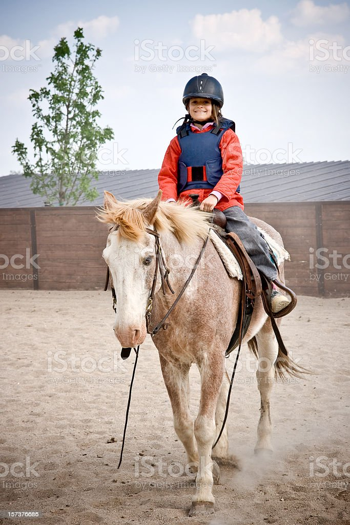 Little girl riding a horse royalty-free stock photo