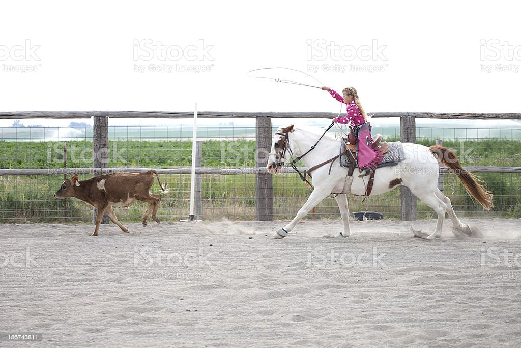 Little Girl Riding Horse Practicing Rodeo Roping a Steer royalty-free stock photo