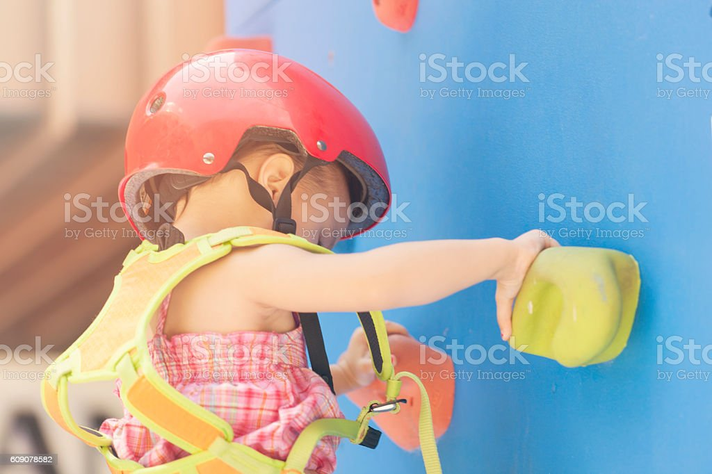 Little Girl Rock Climbing stock photo