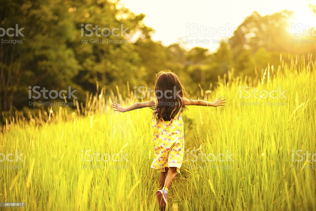 Little girl running stock photo