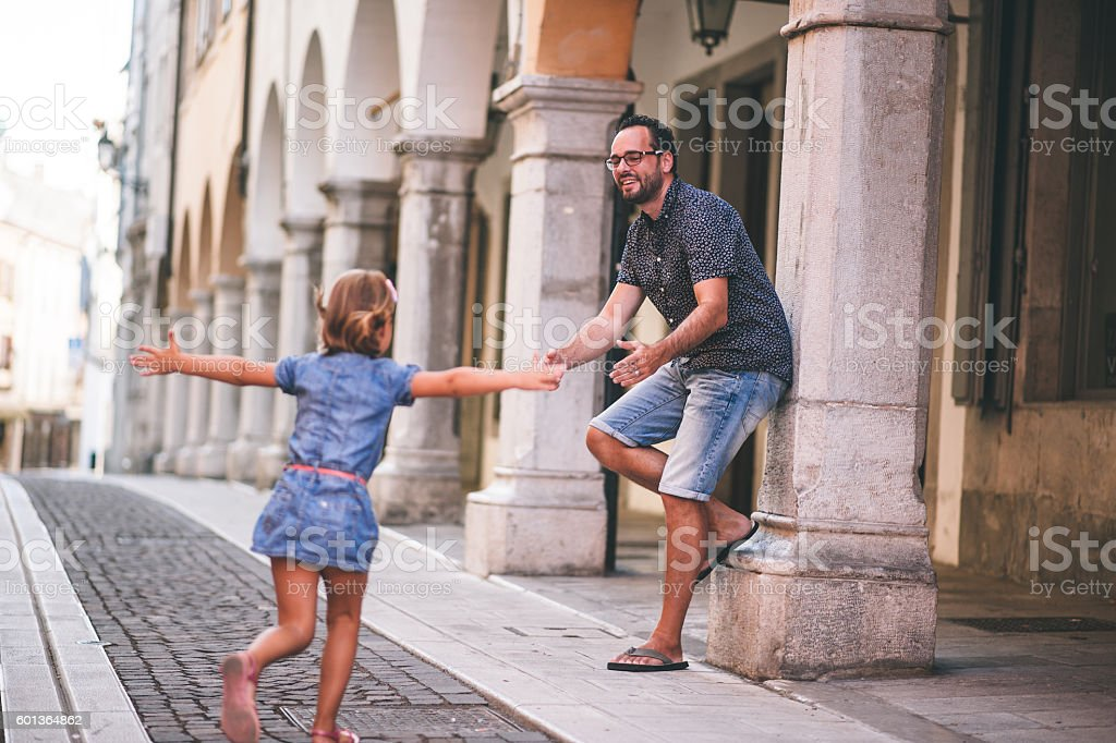 Little Girl Running To Her Father stock photo