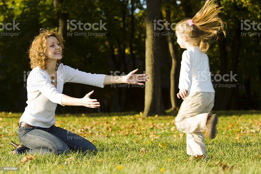 Little Girl Running Towards Her Mother in Park royalty-free stock photo