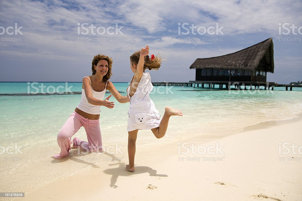 Little Girl Running Towards Her Mother on Tropical Beach royalty-free stock photo