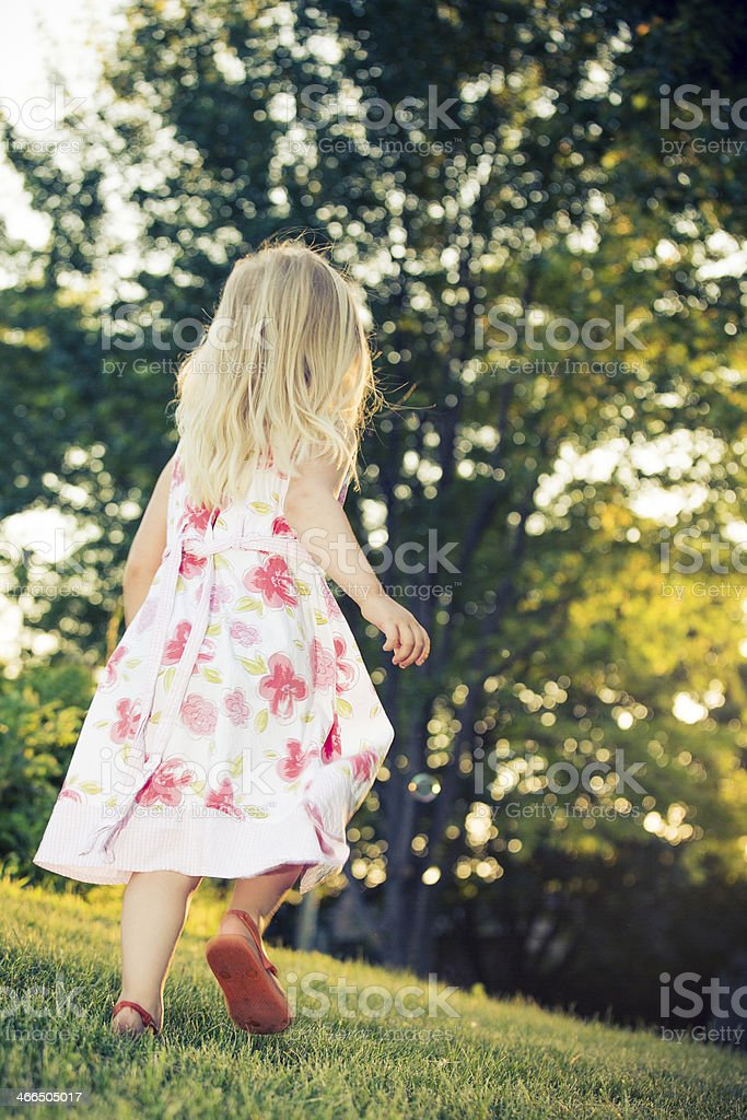 little girl running with sunset royalty-free stock photo