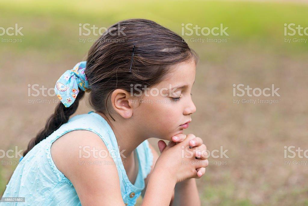 Little girl saying his prayers stock photo