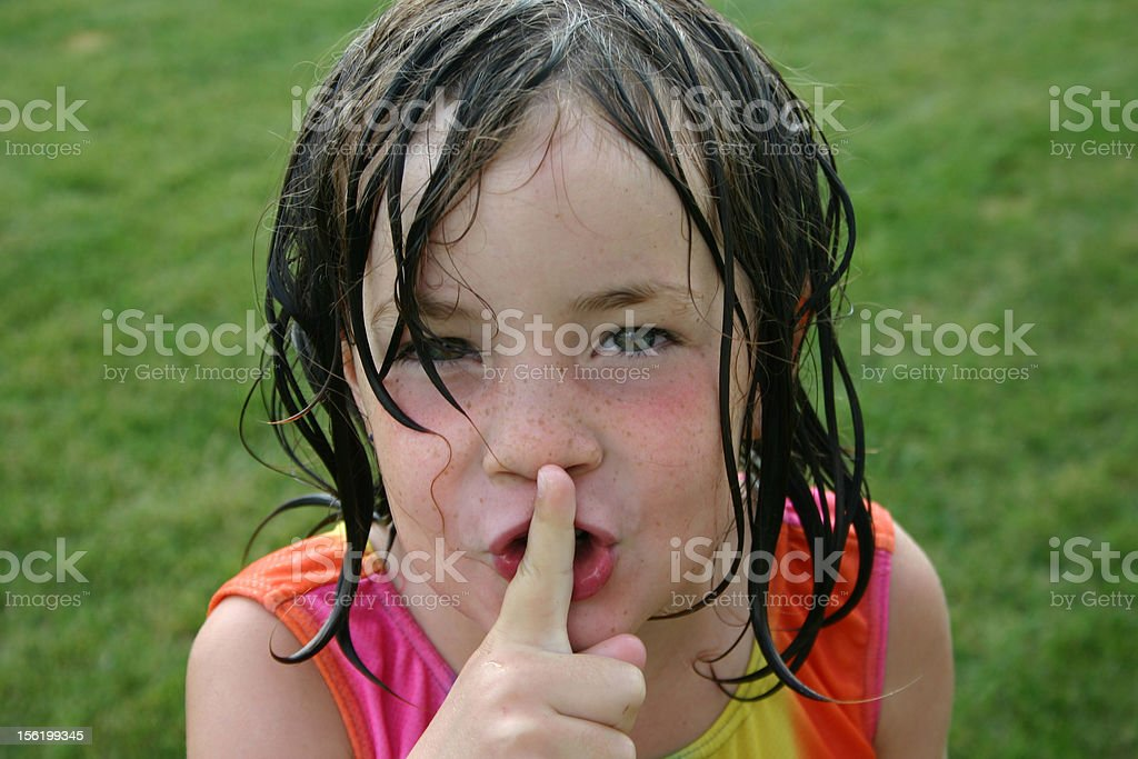 Little girl saying 'Shhhh...' stock photo