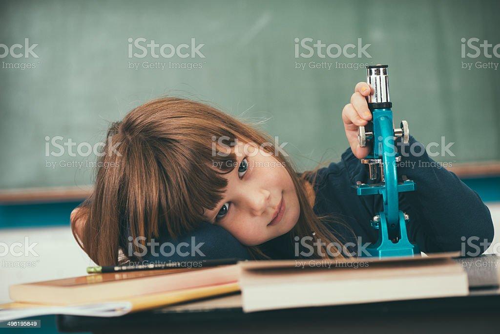 Little Girl Schooler Sitting at School Desk stock photo