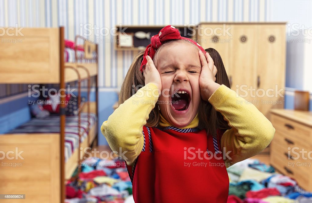 Little girl screaming stock photo