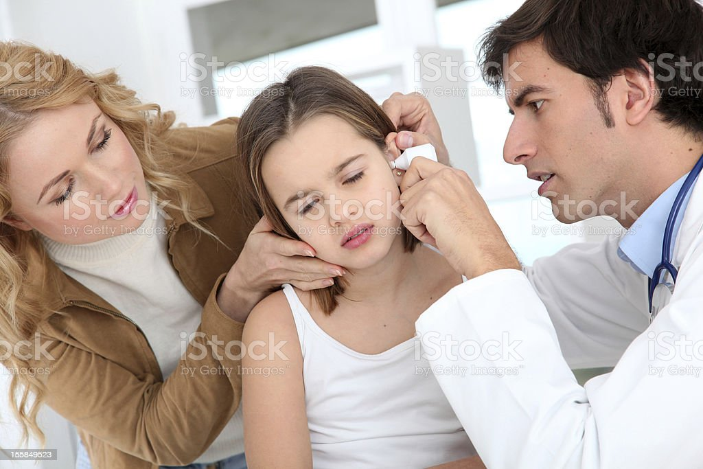 Little girl seeing doctor stock photo