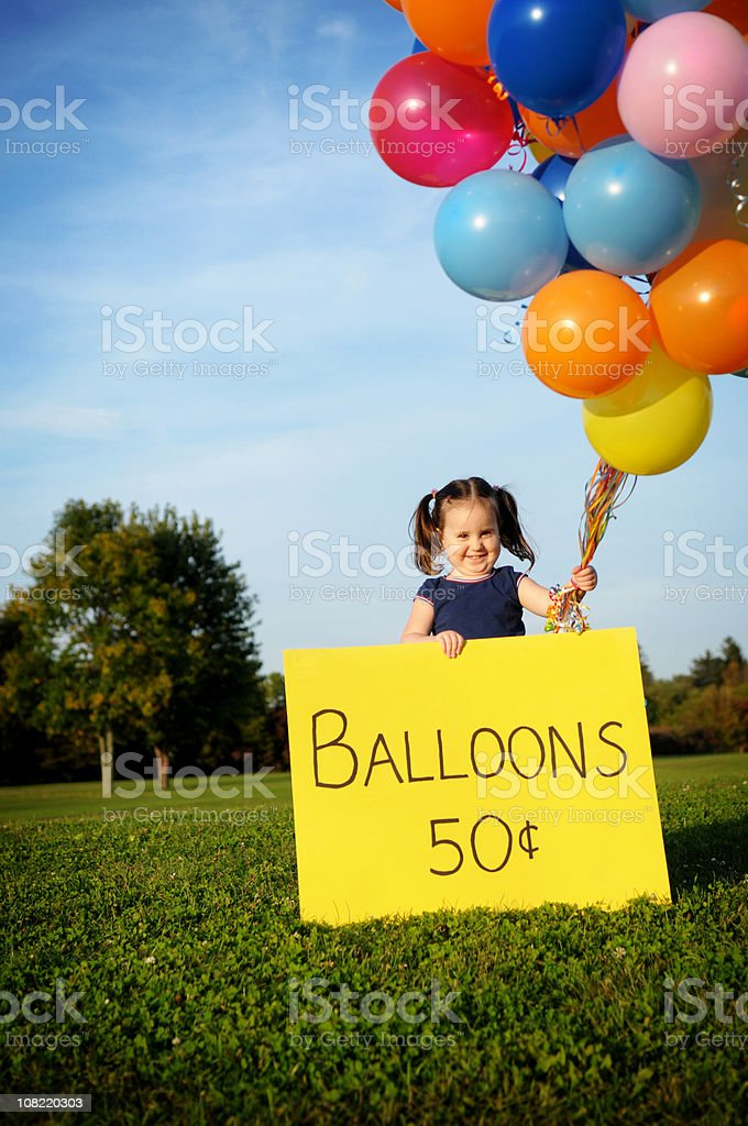 Little Girl Selling Bunch of Balloons royalty-free stock photo
