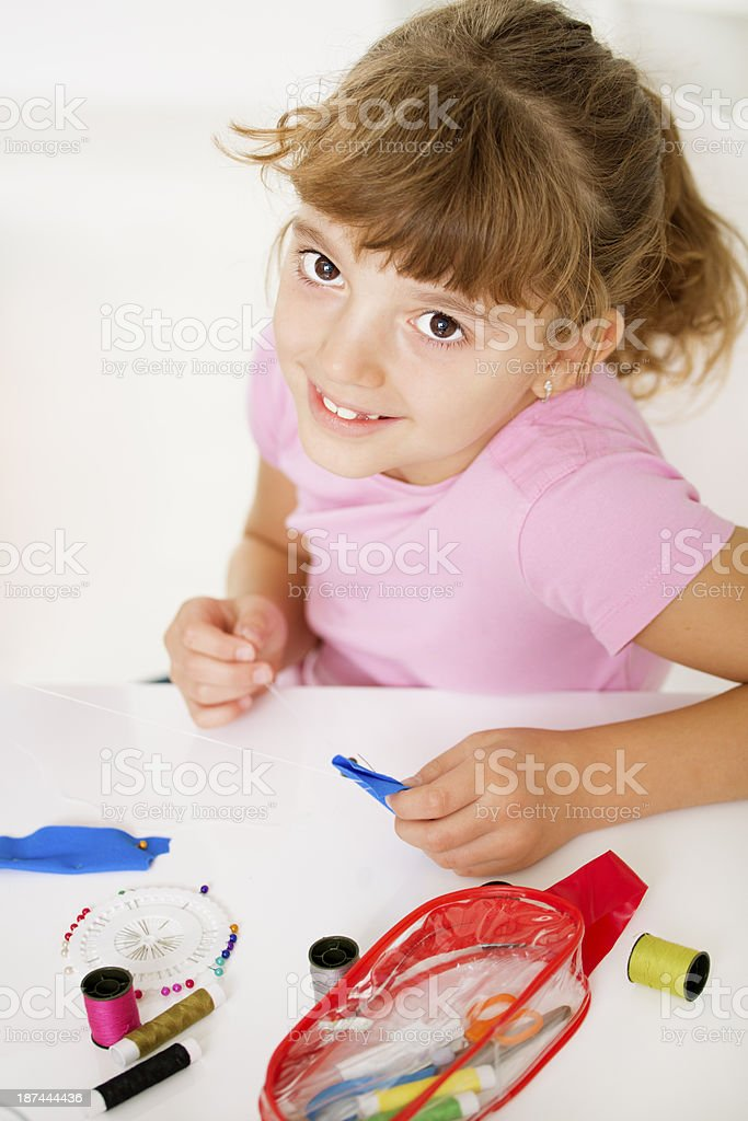 Little girl sewing. royalty-free stock photo