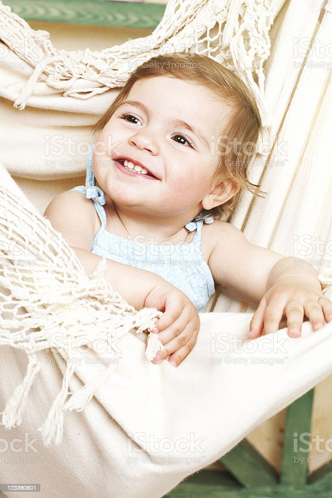 little girl shakes in a soft hammock royalty-free stock photo