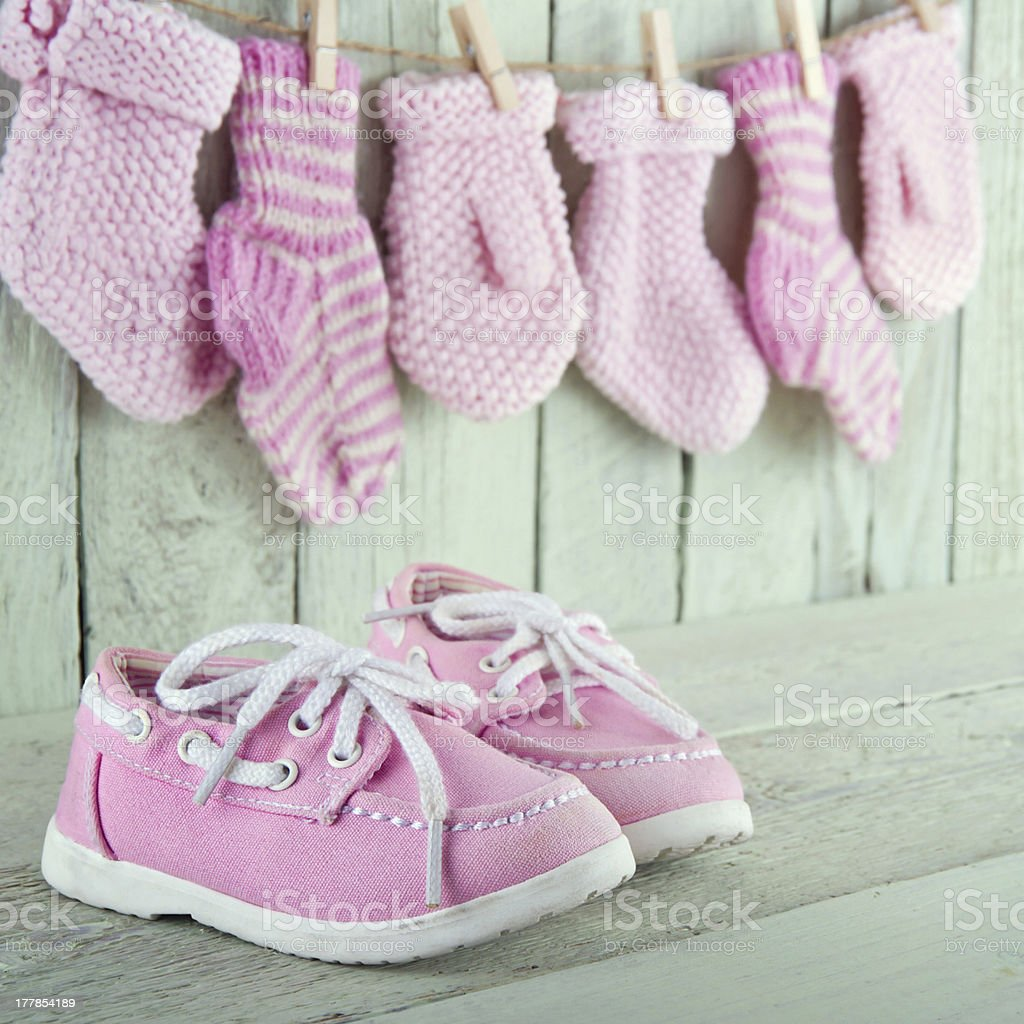 Little girl shoes on green background royalty-free stock photo