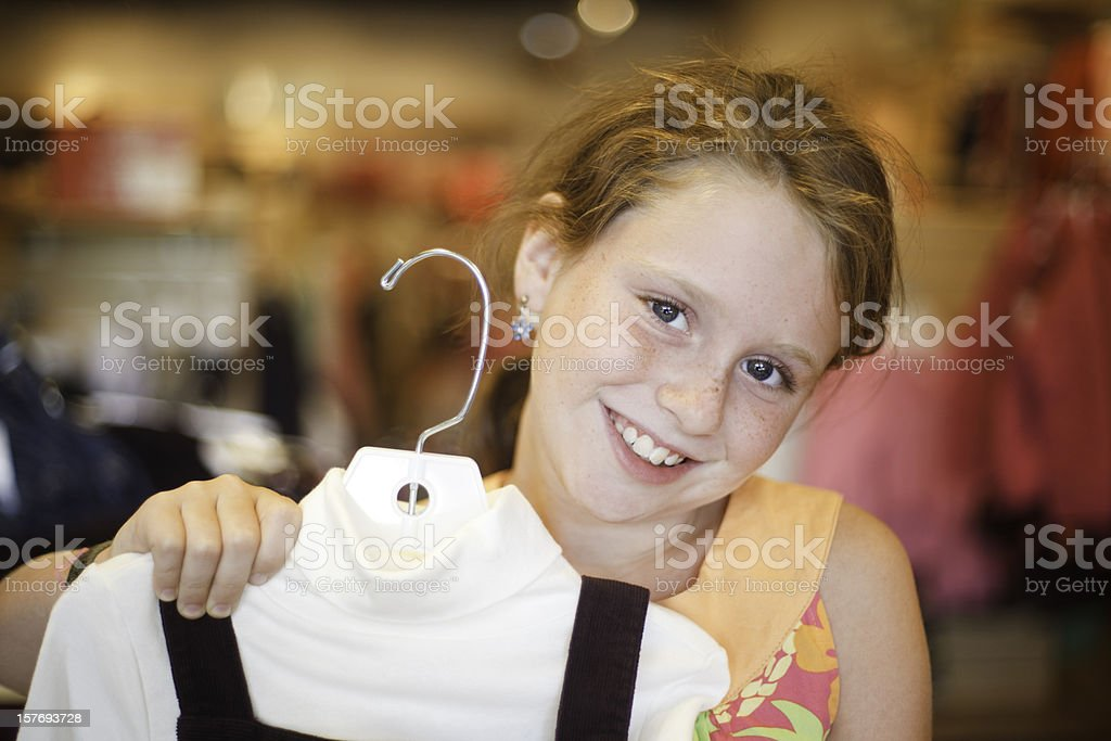 Little girl Shopping clothes in the store royalty-free stock photo