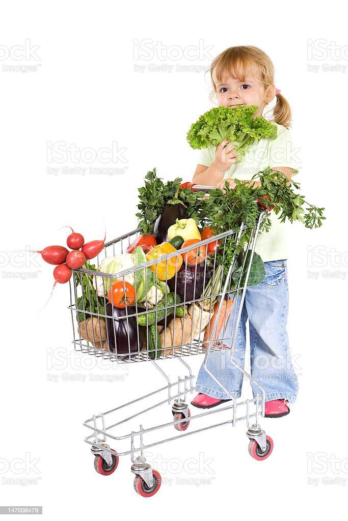 Little girl shopping for vegetables royalty-free stock photo