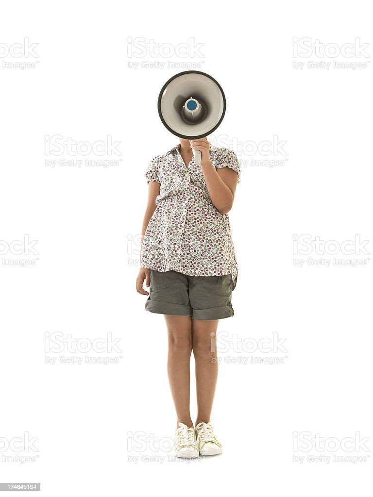 Little girl shouting into megaphone royalty-free stock photo