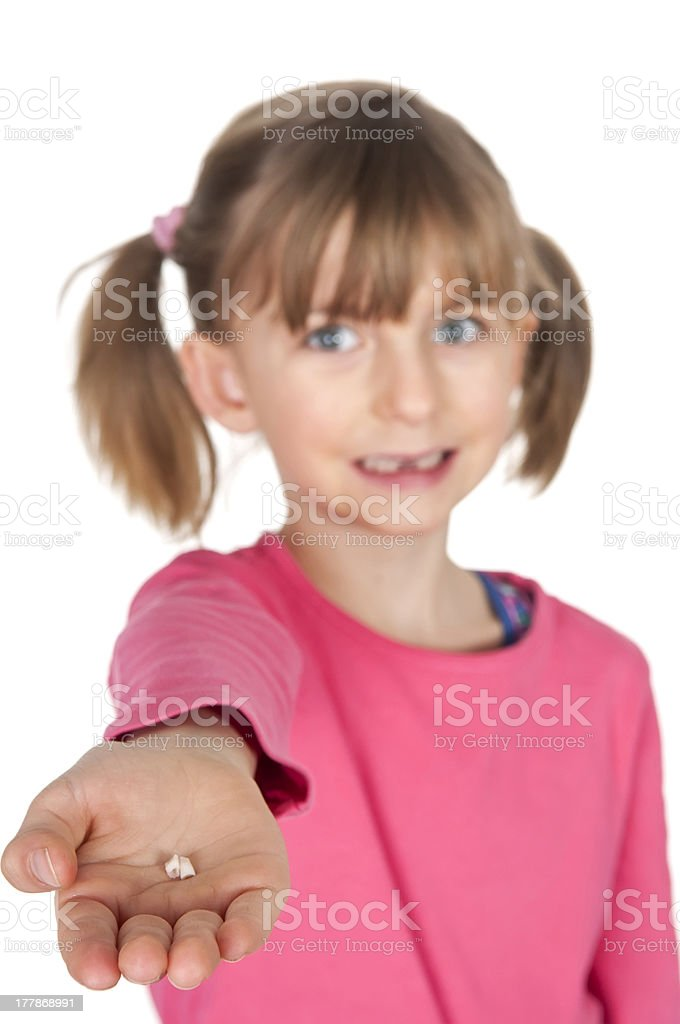 Little girl showing her fallen out milk tooth stock photo
