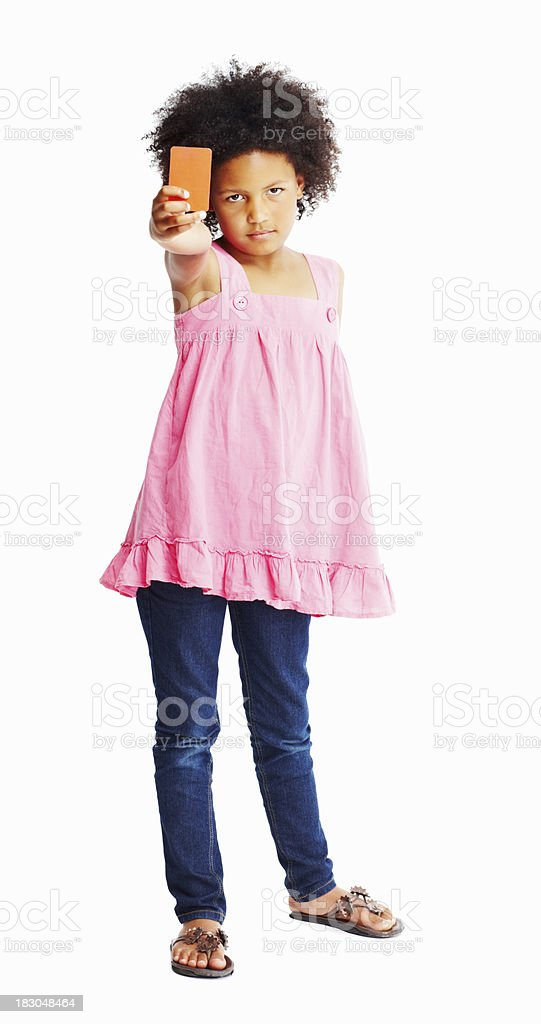 Little girl showing red card isolated against white royalty-free stock photo