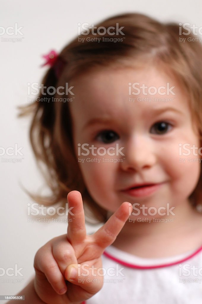 Little Girl Showing She's Two Years Old royalty-free stock photo