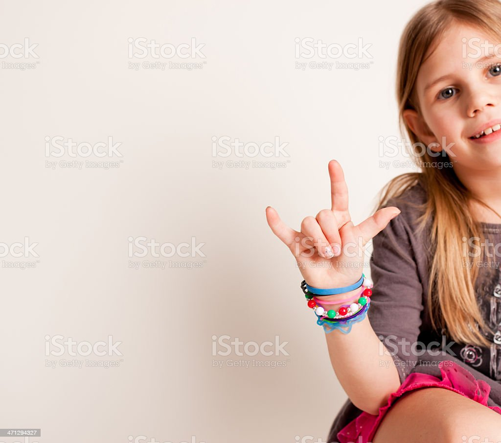 Little Girl Showing Sign for I Love You royalty-free stock photo
