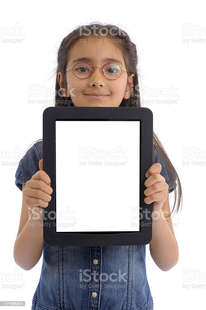 Little girl showing white screen tablet pc royalty-free stock photo