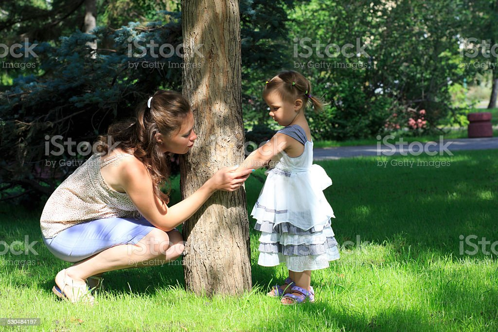 Little girl shows her mother insect bite (in a city stock photo