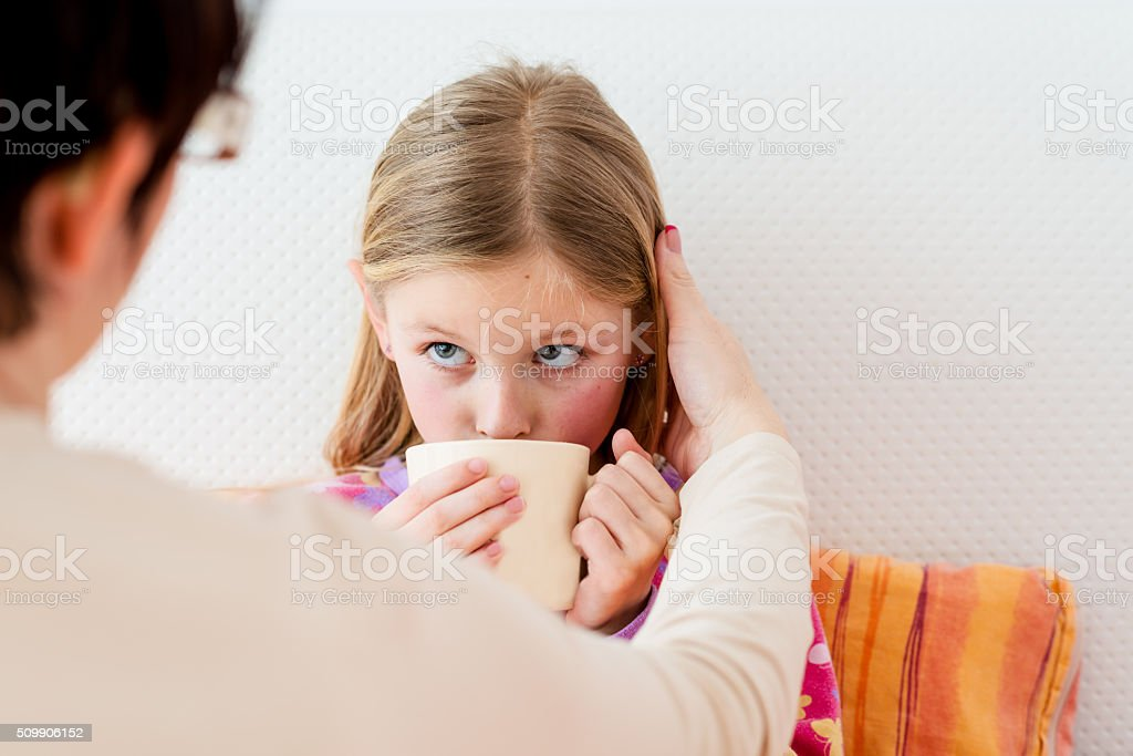 Little girl sick in bed stock photo