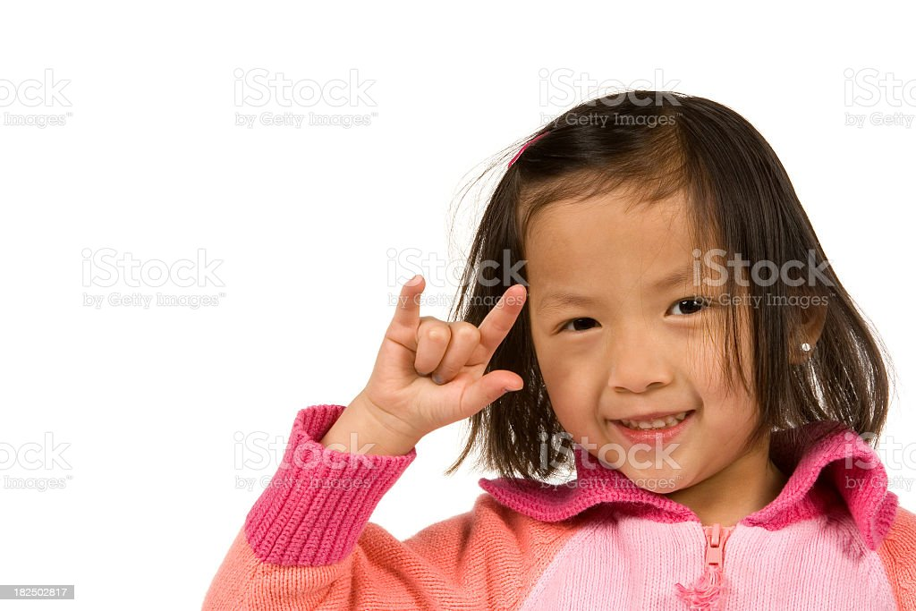 Little girl signing I love you stock photo