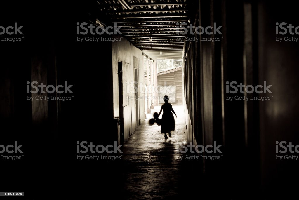little girl silhouette in dirty alley with balloons stock photo