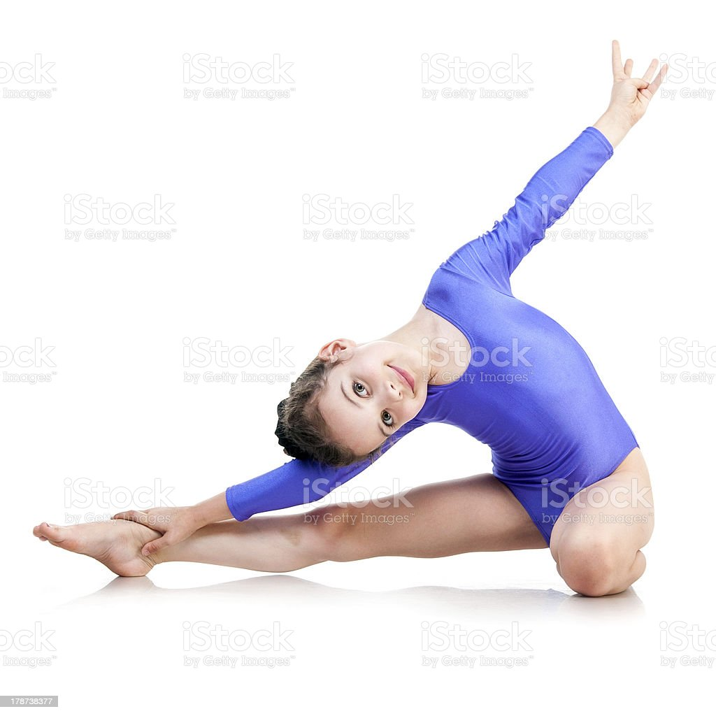little girl sits on a splits stock photo