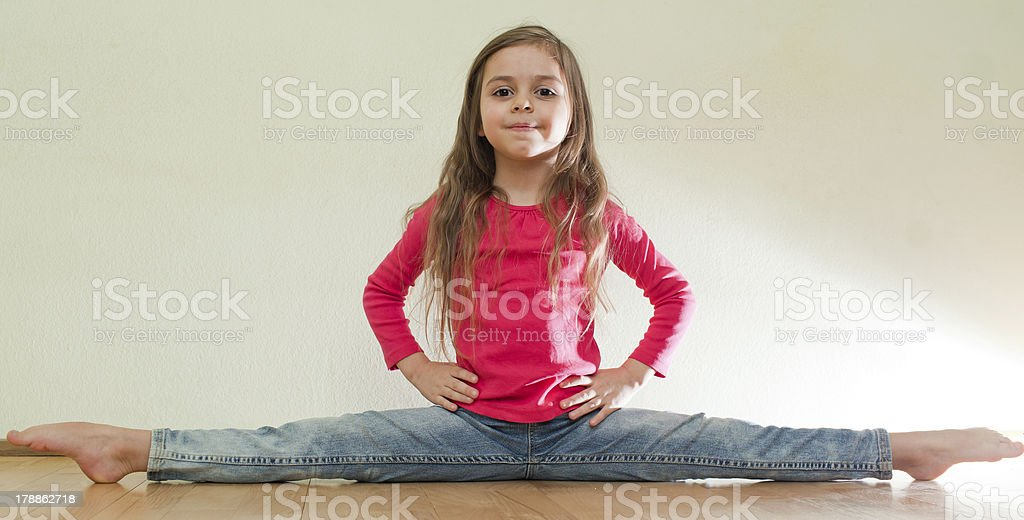 Little girl sits on a splits royalty-free stock photo