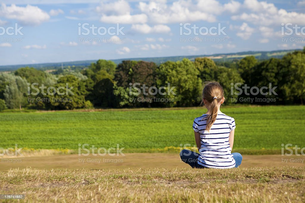 Little girl sitting deep in thought royalty-free stock photo