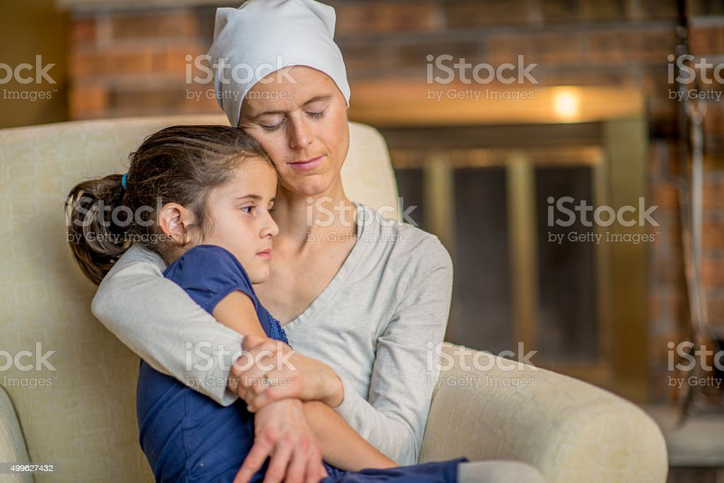 Little Girl Sitting in Her Mother's Lap stock photo