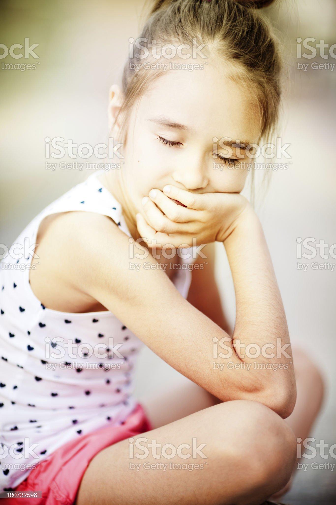 Little girl sitting in the warm, summer sun royalty-free stock photo