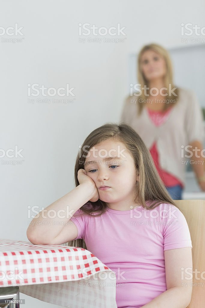 Little girl sitting looking exasperated royalty-free stock photo